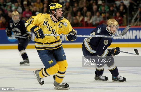Kevin Porter of the Michigan Wolverines and Ryan Thang of the Notre Dame Fighting Irish pursue the play in the semifinal game at the 2008 NCAA Frozen...