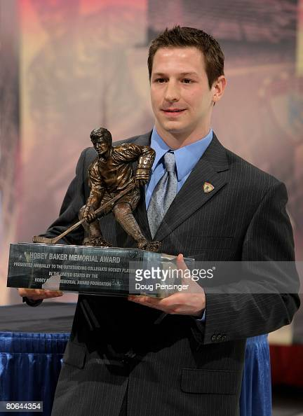 Kevin Porter of the Michigan Wolverines is awarded the 2008 Hobey Baker Award at a ceremony during the 2008 Frozen Four Men's Ice Hockey National...
