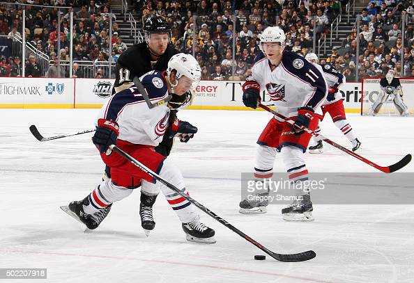Kevin Porter of the Pittsburgh Penguins battles for the puck against Ryan Murray of the Columbus Blue Jackets at Consol Energy Center on December 21...
