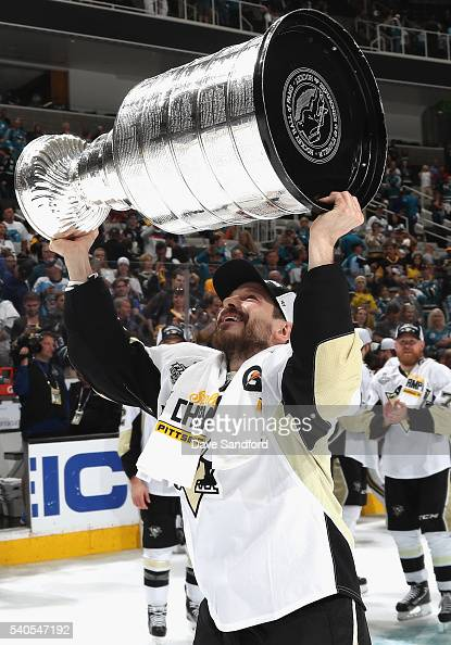 Kevin Porter of the Pittsburgh Penguins celebrates with the Stanley Cup after the Penguins won Game 6 of the 2016 NHL Stanley Cup Final over the San...