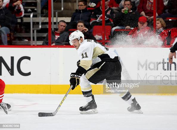 Kevin Porter of the Pittsburgh Penguins controls the puck on the ice during an NHL game against the Carolina Hurricanes at PNC Arena on January 12...