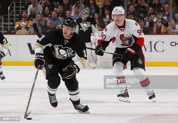 Kevin Porter of the Pittsburgh Penguins moves the puck up ice in front of Alex Chiasson of the Ottawa Senators at Consol Energy Center on February 2...
