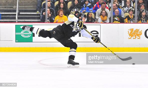 Kevin Porter of the Pittsburgh Penguins shoots the puck against the New Jersey Devils at Consol Energy Center on January 26 2016 in Pittsburgh...