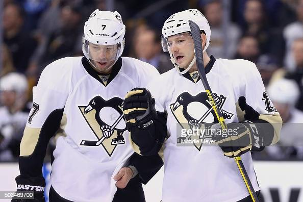 Kevin Porter of the Pittsburgh Penguins talks with Matt Cullen during the third period against the Boston Bruins at TD Garden on December 16 2015 in...