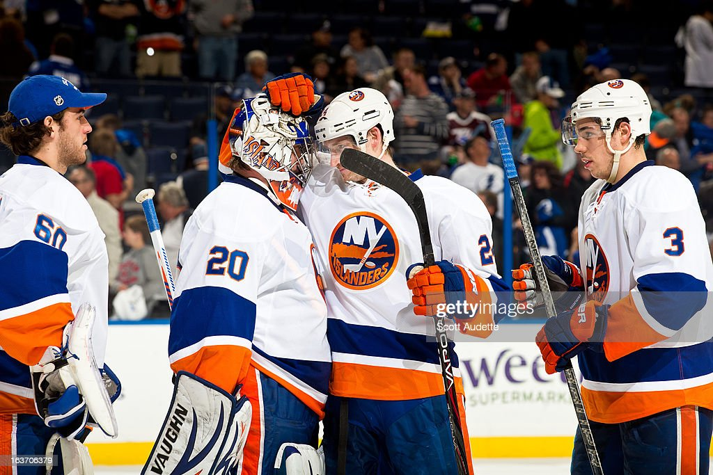 Kevin Poulin #60, <a gi-track='captionPersonalityLinkClicked' href=/galleries/search?phrase=Evgeni+Nabokov&family=editorial&specificpeople=171380 ng-click='$event.stopPropagation()'>Evgeni Nabokov</a> #20, Brad Boyles #24 and <a gi-track='captionPersonalityLinkClicked' href=/galleries/search?phrase=Travis+Hamonic&family=editorial&specificpeople=4605791 ng-click='$event.stopPropagation()'>Travis Hamonic</a> #3 of the New York Islanders celebrate after defeating the Tampa Bay Lightning 1-0 at the Tampa Bay Times Forum on March 14, 2013 in Tampa, Florida.