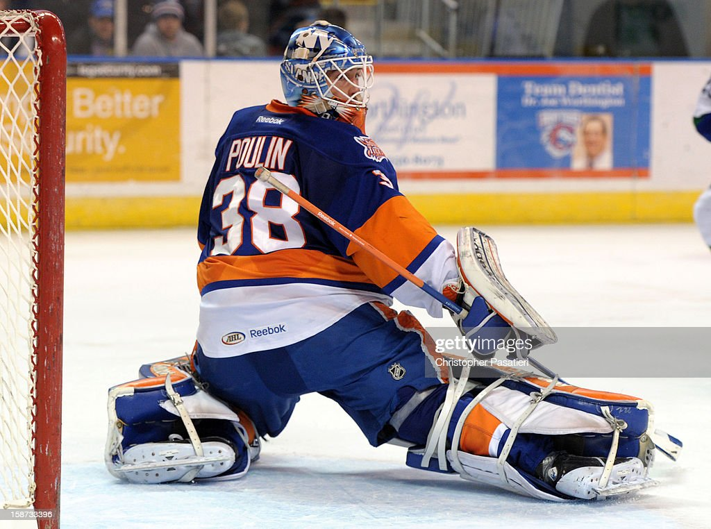 Kevin Poulin #38 of the Bridgeport Sound Tigers looks back after deflecting a shot on goal during an American Hockey League game against the Connecticut Whale on December 26, 2012 at the Webster Bank Arena at Harbor Yard in Bridgeport, Connecticut.