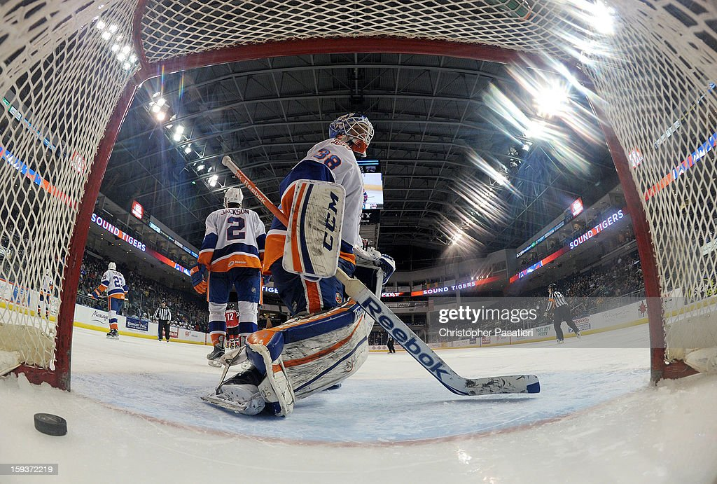 Kevin Poulin #38 of the Bridgeport Sound Tigers looks in the net after allowing a goal during an American Hockey League game against the Portland Pirates on January 12, 2013 at the Webster Bank Arena at Harbor Yard in Bridgeport, Connecticut.