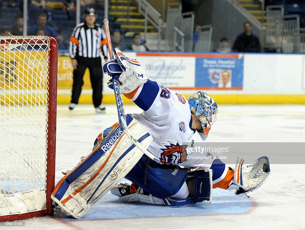 Kevin Poulin #38 of the Bridgeport Sound Tigers makes a glove save during an American Hockey League game against the Portland Pirates on January 12, 2013 at the Webster Bank Arena at Harbor Yard in Bridgeport, Connecticut.