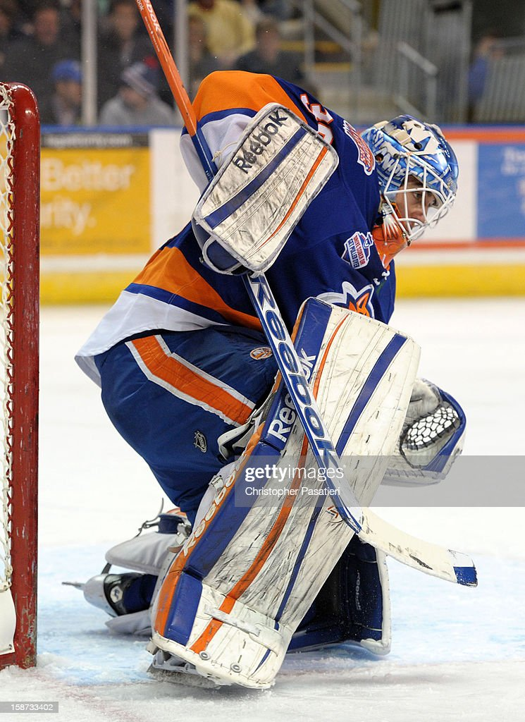 Kevin Poulin #38 of the Bridgeport Sound Tigers makes a save as he tends goal during an American Hockey League game against the Connecticut Whale on December 26, 2012 at the Webster Bank Arena at Harbor Yard in Bridgeport, Connecticut.