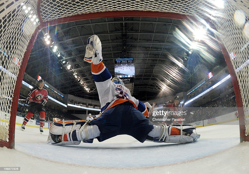 Kevin Poulin #38 of the Bridgeport Sound Tigers makes a save during an American Hockey League game against the Portland Pirates on January 12, 2013 at the Webster Bank Arena at Harbor Yard in Bridgeport, Connecticut.
