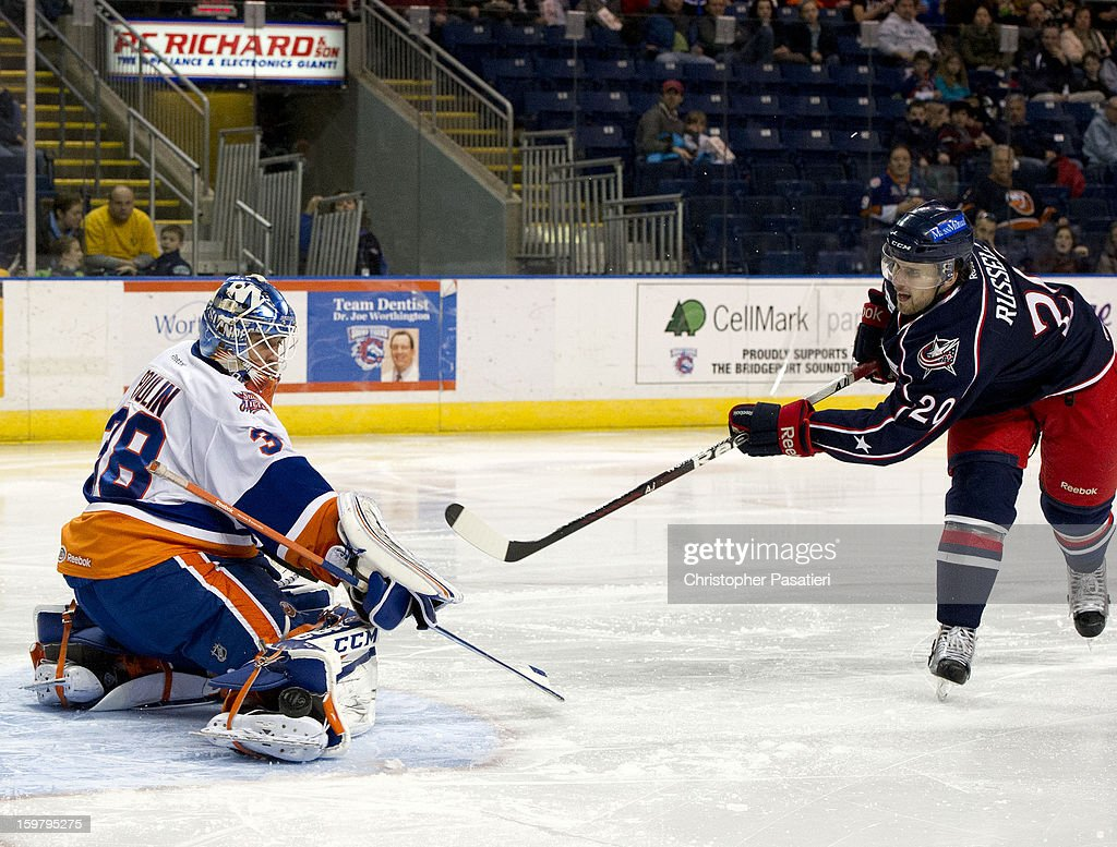 Kevin Poulin #38 of the Bridgeport Sound Tigers stops penalty shot against Ryan Russell #20 of the Springfield Falcons during an American Hockey League game on January 20, 2013 at the Webster Bank Arena at Harbor Yard in Bridgeport, Connecticut.