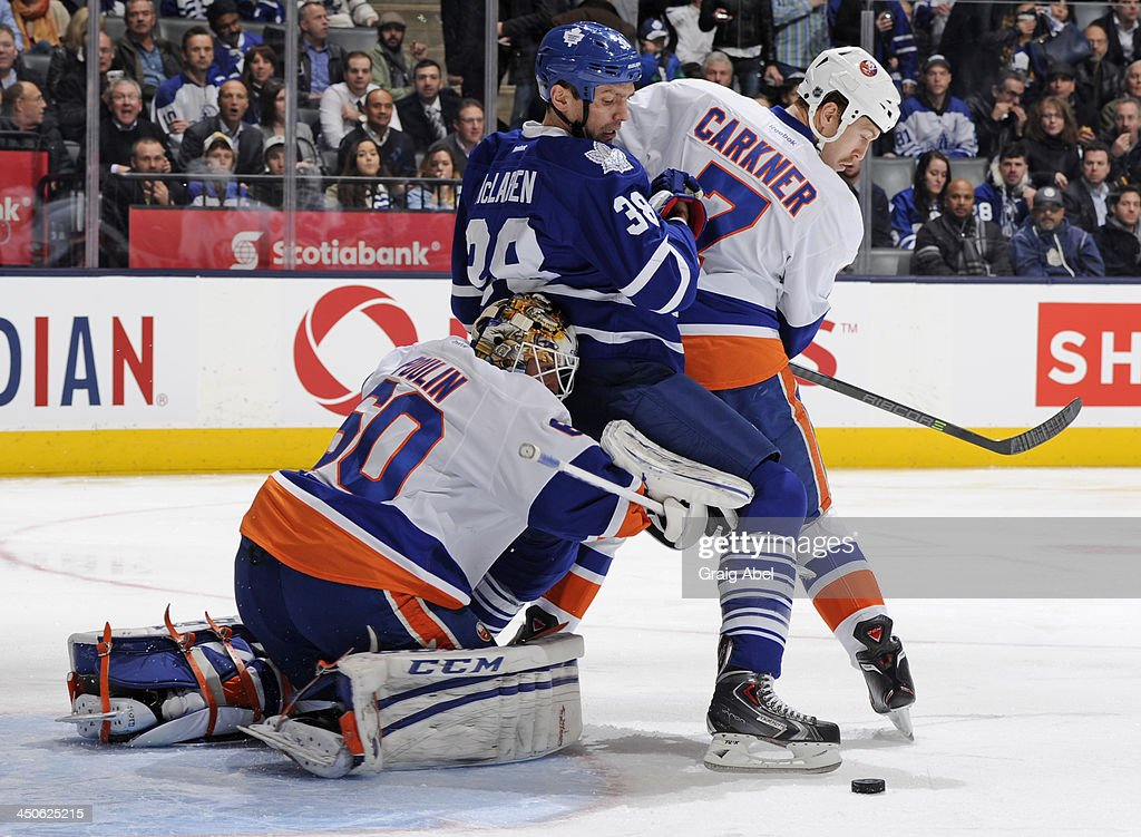 <a gi-track='captionPersonalityLinkClicked' href=/galleries/search?phrase=Kevin+Poulin&family=editorial&specificpeople=4952456 ng-click='$event.stopPropagation()'>Kevin Poulin</a> #60 of the New York Islanders defends the goal as teammate <a gi-track='captionPersonalityLinkClicked' href=/galleries/search?phrase=Matt+Carkner&family=editorial&specificpeople=556901 ng-click='$event.stopPropagation()'>Matt Carkner</a> #7 battles with <a gi-track='captionPersonalityLinkClicked' href=/galleries/search?phrase=Frazer+McLaren&family=editorial&specificpeople=4601054 ng-click='$event.stopPropagation()'>Frazer McLaren</a> #38 of the Toronto Maple Leafs during NHL game action November 19, 2013 at the Air Canada Centre in Toronto, Ontario, Canada.