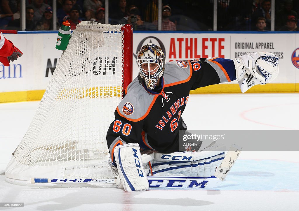 <a gi-track='captionPersonalityLinkClicked' href=/galleries/search?phrase=Kevin+Poulin&family=editorial&specificpeople=4952456 ng-click='$event.stopPropagation()'>Kevin Poulin</a> #60 of the New York Islanders in action against the Detroit Red Wings during their game at the Nassau Veterans Memorial Coliseum on November 16, 2013 in Uniondale, New York.