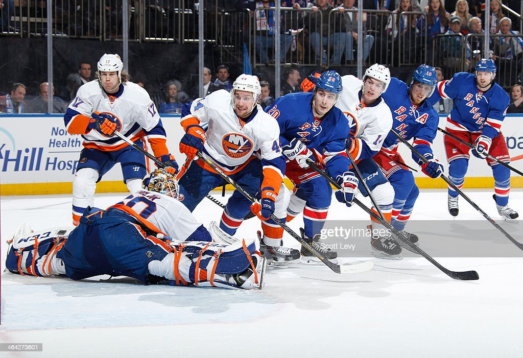 <a gi-track='captionPersonalityLinkClicked' href=/galleries/search?phrase=Kevin+Poulin&family=editorial&specificpeople=4952456 ng-click='$event.stopPropagation()'>Kevin Poulin</a> #60 of the New York Islanders makes a save with traffic in front of the net against the New York Rangers at Madison Square Garden on January 21, 2014 in New York City.