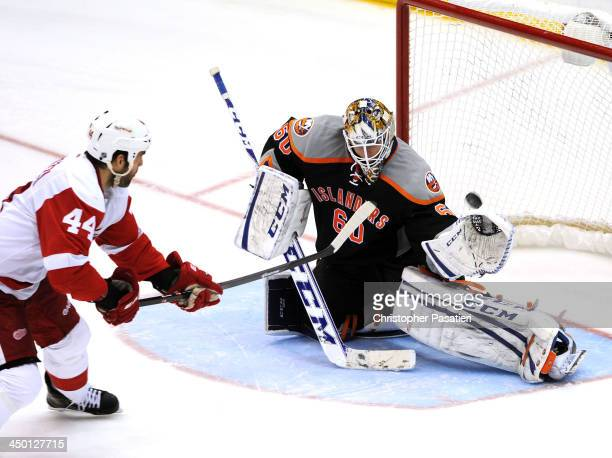 Kevin Poulin of the New York Islanders makes the game winning save against Todd Bertuzzi of the Detroit Red Wings during the shootout on November 16...