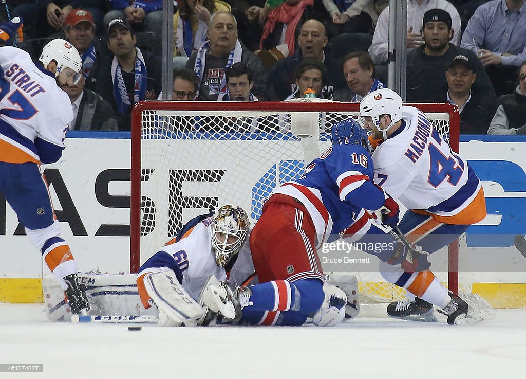 <a gi-track='captionPersonalityLinkClicked' href=/galleries/search?phrase=Kevin+Poulin&family=editorial&specificpeople=4952456 ng-click='$event.stopPropagation()'>Kevin Poulin</a> #60 of the New York Islanders makes the save against the New York Rangers at Madison Square Garden on January 21, 2014 in New York City.