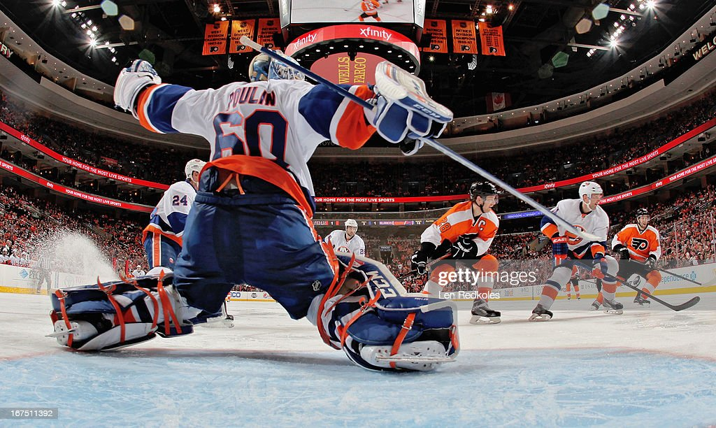 <a gi-track='captionPersonalityLinkClicked' href=/galleries/search?phrase=Kevin+Poulin&family=editorial&specificpeople=4952456 ng-click='$event.stopPropagation()'>Kevin Poulin</a> #60 of the New York Islanders slides across the crease during a game against the Philadelphia Flyers on April 25, 2013 at the Wells Fargo Center in Philadelphia, Pennsylvania. The Flyers went on to defeat the Islanders 2-1.