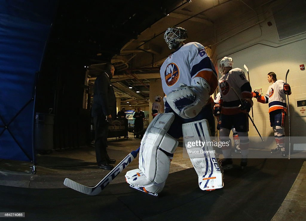 <a gi-track='captionPersonalityLinkClicked' href=/galleries/search?phrase=Kevin+Poulin&family=editorial&specificpeople=4952456 ng-click='$event.stopPropagation()'>Kevin Poulin</a> #60 of the New York Islanders walks out to face the New York Rangers at Madison Square Garden on January 21, 2014 in New York City. The Islanders defeated the Rangers 5-3.
