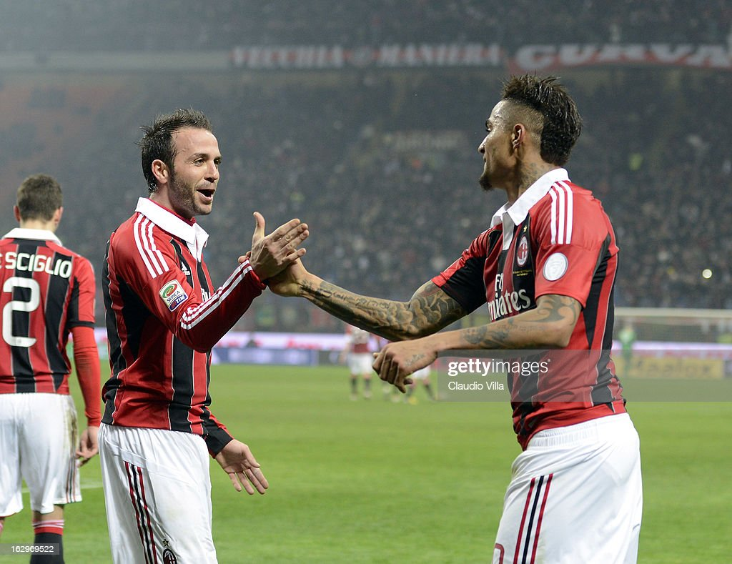 Kevin Price Boateng of AC Milan (R) celebrates his goal with team-mate Giampaolo Pazzini during the Serie A match between AC Milan and S.S. Lazio at San Siro Stadium on March 2, 2013 in Milan, Italy.