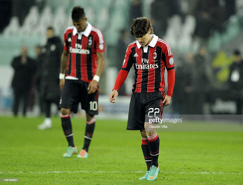 Kevin Prince Boateng (L) and Bojan Krkic of AC Milan look dejected after the TIM cup match between Juventus FC and AC Milan at Juventus Arena on January 9, 2013 in Turin, Italy.