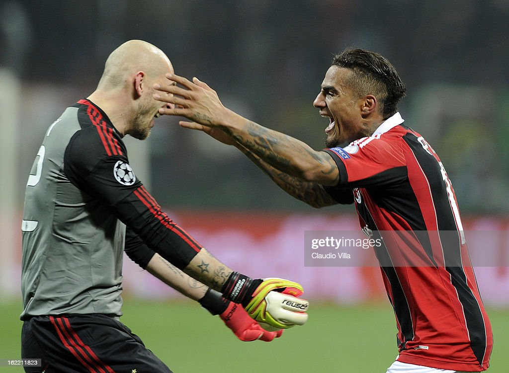 Kevin Prince Boateng and Cristian Abbiati (L) of AC Milan celebrate victory at the end of the UEFA Champions League Round of 16 first leg match between AC Milan and Barcelona at San Siro Stadium on February 20, 2013 in Milan, Italy.