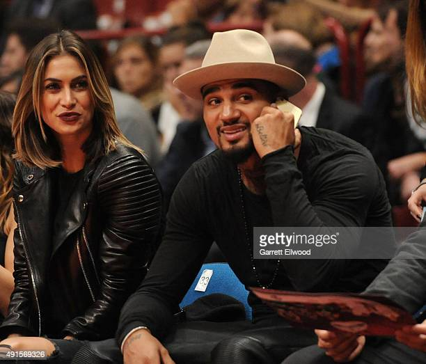 Kevin Prince Boateng and Melissa Satta enjoy the game between the Boston Celtics and Emporio Armani Milano as part of the 2015 Global Games on...