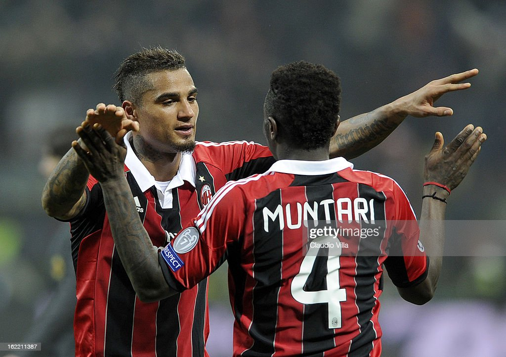 Kevin Prince Boateng and Sulley Muntari of AC Milan celebrate victory at the end of the UEFA Champions League Round of 16 first leg match between AC Milan and Barcelona at San Siro Stadium on February 20, 2013 in Milan, Italy.