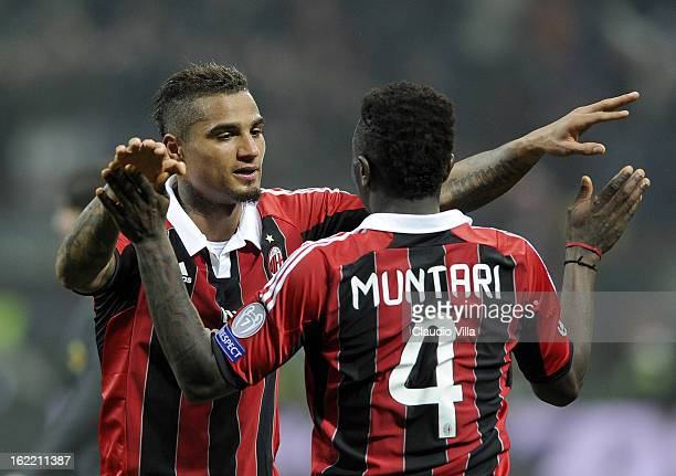 Kevin Prince Boateng and Sulley Muntari of AC Milan celebrate victory at the end of the UEFA Champions League Round of 16 first leg match between AC...
