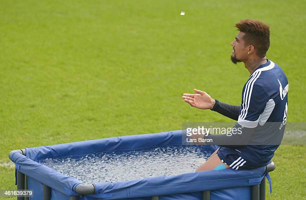 Kevin Prince Boateng is seen in ice water during a FC Schalke 04 training session at ASPIRE Academy for Sports Excellence on January 10 2014 in Doha...