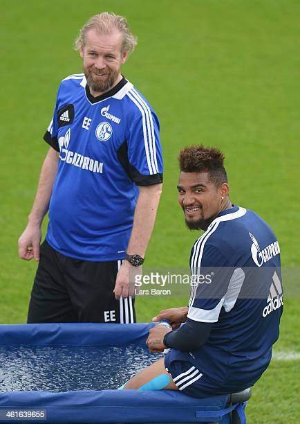 Kevin Prince Boateng is seen in ice water next to physiotherapist Egil Eliassen during a FC Schalke 04 training session at ASPIRE Academy for Sports...