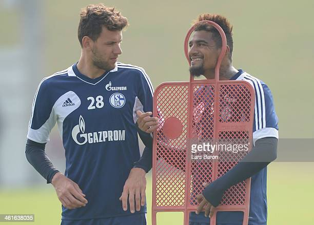 Kevin Prince Boateng jokes with Adam Szalai during a FC Schalke 04 training session at ASPIRE Academy for Sports Excellence on January 10 2014 in...