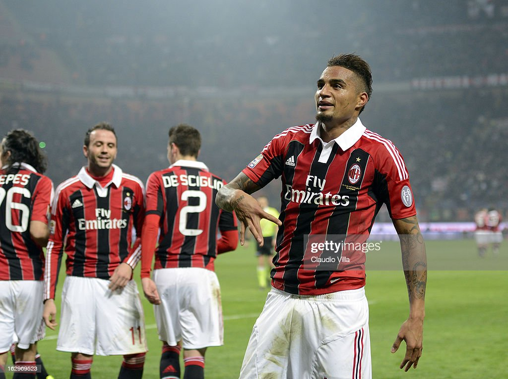 Kevin Prince Boateng of AC Milan (R) celebrates scoring the second goal during the Serie A match between AC Milan and S.S. Lazio at San Siro Stadium on March 2, 2013 in Milan, Italy.