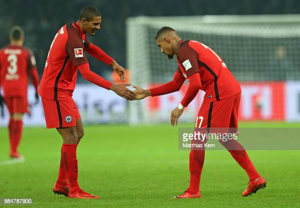 Kevin Prince Boateng of Frankfurt jubilates with team mate Sebastien Haller after scoring the third goal during the Bundesliga match between Hertha...