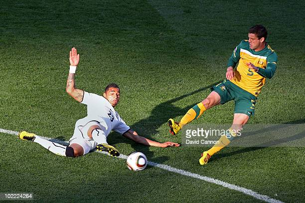 Kevin Prince Boateng of Ghana tackles Jason Culina of Australia during the 2010 FIFA World Cup South Africa Group D match between Ghana and Australia...