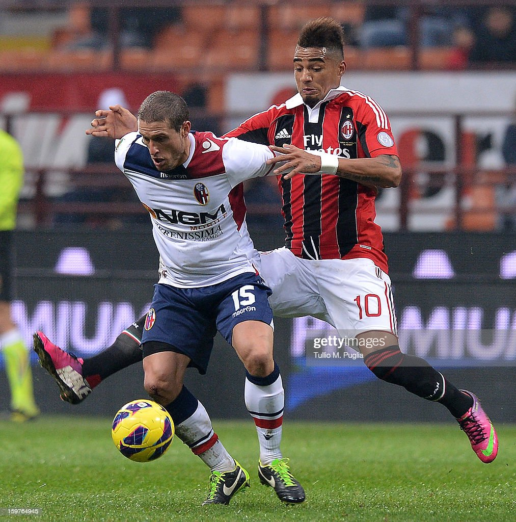 Kevin Prince Boateng (R) of Milan and Diego Perez (L) of Bologna compete for the ball during the Serie A match between AC Milan and Bologna FC at San Siro Stadium on January 20, 2013 in Milan, Italy.