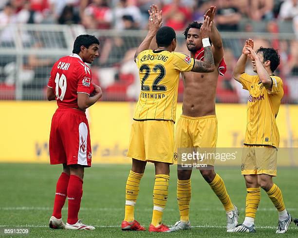 Kevin Prince Boateng Patrick Owomoyela and Tamas Hajnal of Dortmund celebrates next to Adil Chihi of Koeln after winning the Bundesliga match between...