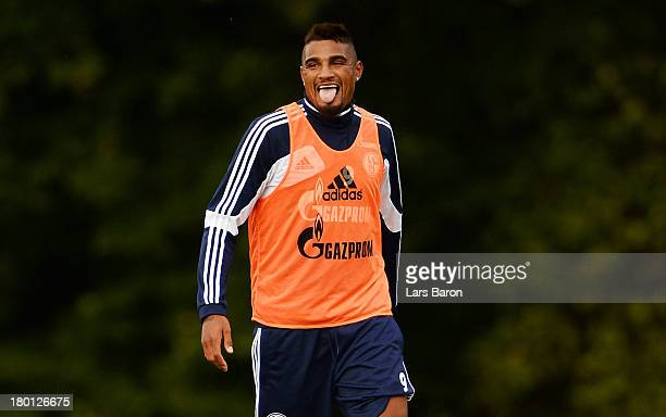 Kevin Prince Boateng reacts during a FC Schalke 04 training session on September 9 2013 in Gelsenkirchen Germany