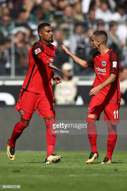 Kevin PrinceBoateng of Frankfurt celebrates scoring his teams first goal to make it 01 with Mijat Gacinovic of Frankfurt during the Bundesliga match...