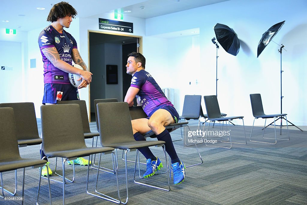 Kevin Proctor and Cooper Cronk (R) wait for the team photograph to take place during a Melbourne Storm NRL media opportunity at AAMI Park on September 26, 2016 in Melbourne, Australia.