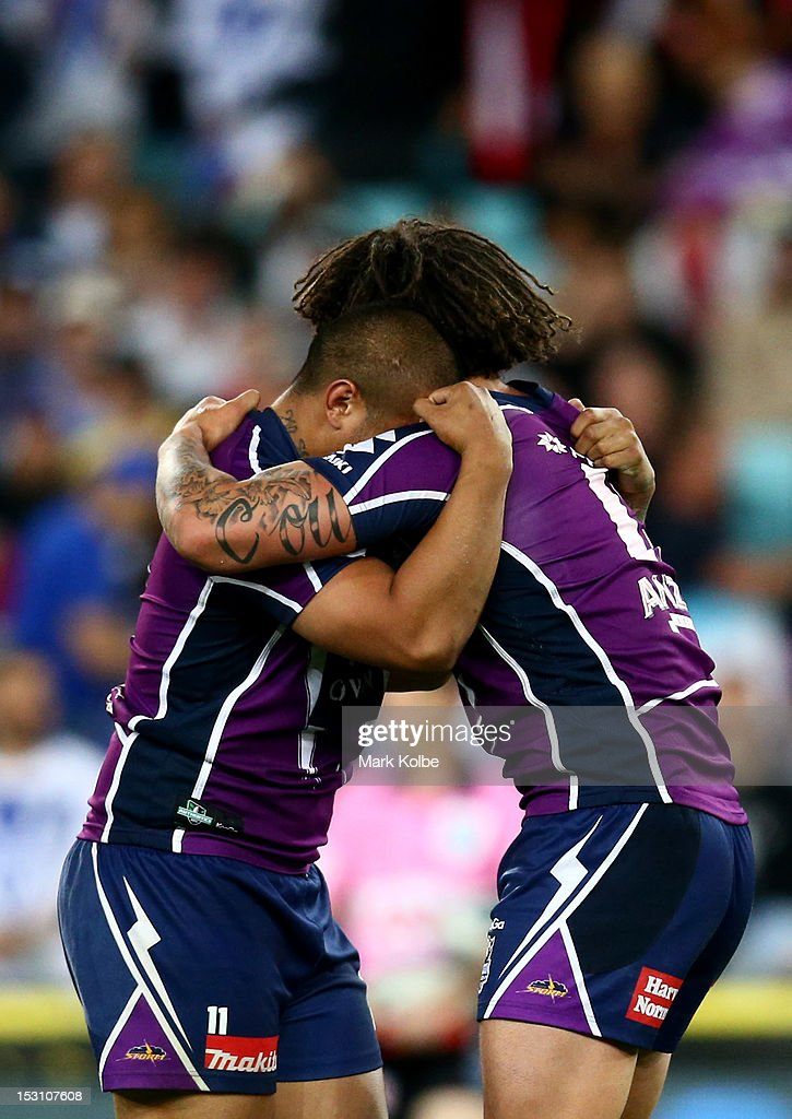 Kevin Proctor and Sika Manu of the Storm celebrate at full-time after winning the 2012 NRL Grand Final match between the Melbourne Storm and the Canterbury Bulldogs at ANZ Stadium on September 30, 2012 in Sydney, Australia.