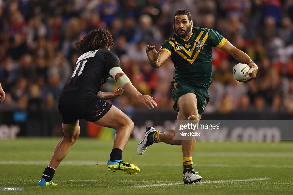 Kevin Proctor of the Kiwis attempts to tackle <a gi-track='captionPersonalityLinkClicked' href=/galleries/search?phrase=Greg+Inglis&family=editorial&specificpeople=597192 ng-click='$event.stopPropagation()'>Greg Inglis</a> of the Kangaroos during the International Rugby League Trans Tasman Test match between the Australian Kangaroos and the New Zealand Kiwis at Hunter Stadium on May 6, 2016 in Newcastle, Australia.