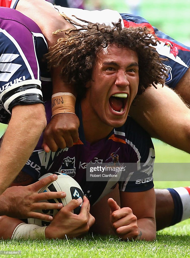 Kevin Proctor of the Storm celebrates as he scores a try during the round four NRL match between the Melbourne Storm and the Sydney Roosters at AAMI Park on March 25, 2012 in Melbourne, Australia.