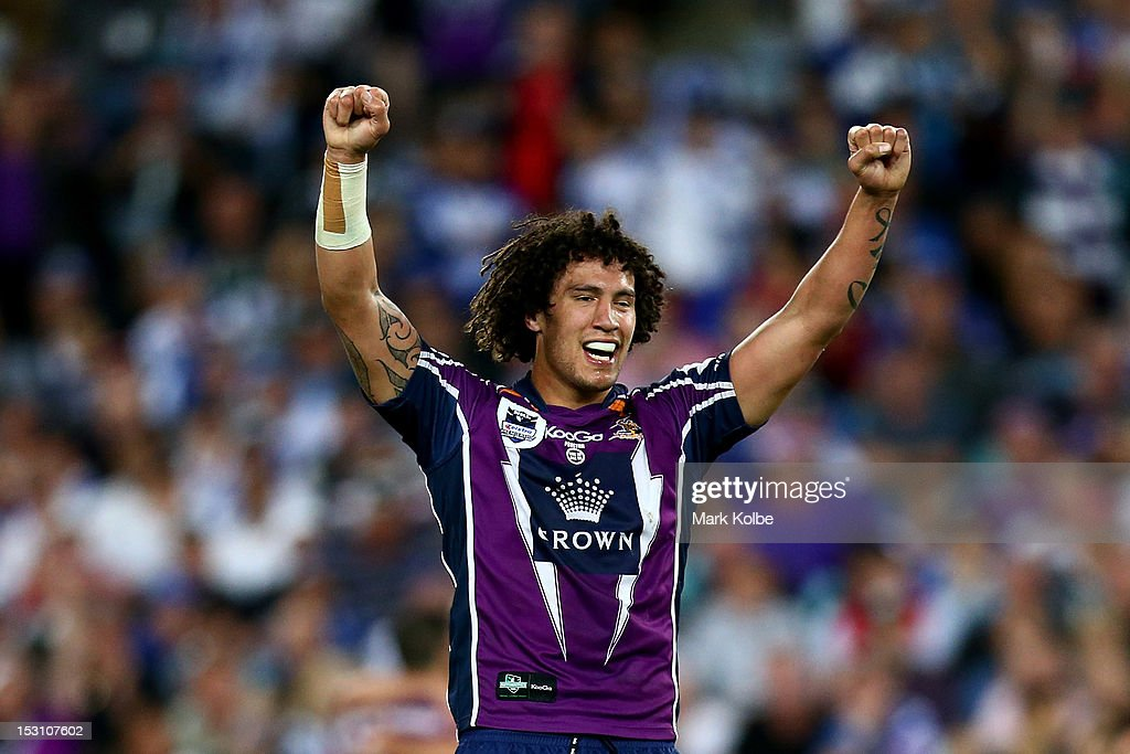 Kevin Proctor of the Storm celebrates at full-time after winning the 2012 NRL Grand Final match between the Melbourne Storm and the Canterbury Bulldogs at ANZ Stadium on September 30, 2012 in Sydney, Australia.