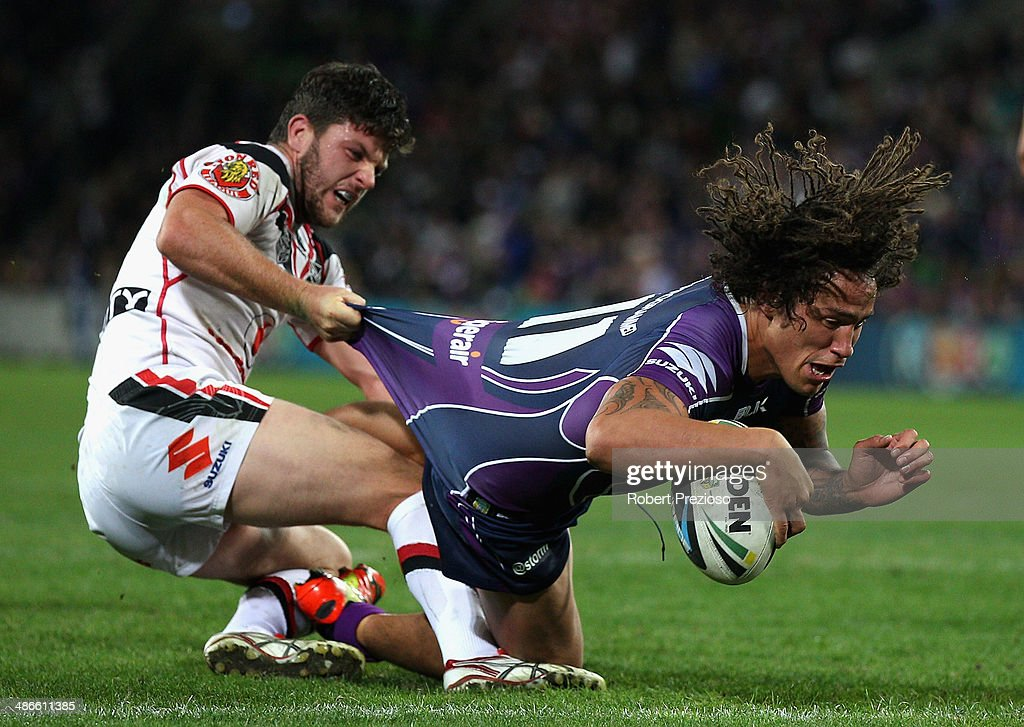 Kevin Proctor of the Storm crosses the line to score a try during the round 8 NRL match between the Melbourne Storm and the New Zealand Warriors at AAMI Park on April 25, 2014 in Melbourne, Australia.