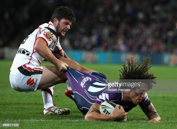 Kevin Proctor of the Storm crosses the line to score a try during the round 8 NRL match between the Melbourne Storm and the New Zealand Warriors at...