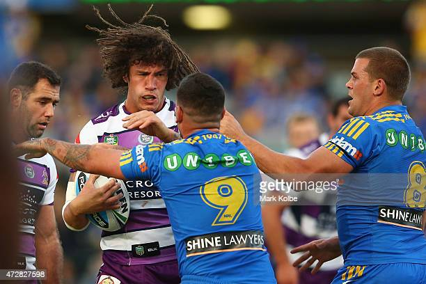 Kevin Proctor of the Storm excahnges heated words with Nathan Peats and Danny Wicks of the Eels during the round nine NRL match between the...