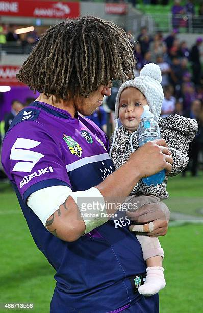 Kevin Proctor of the Storm gives her baby daughter a drink after winning the round five NRL match between the Melbourne Storm and the New Zealand...