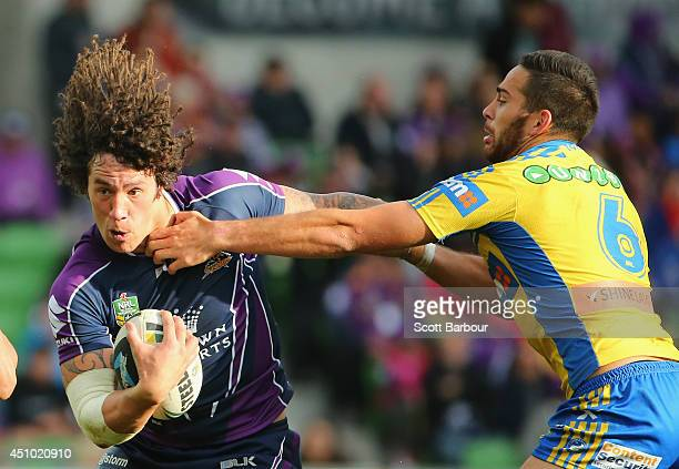 Kevin Proctor of the Storm is tackled by Corey Norman of the Eels during the round 15 NRL match between the Melbourne Storm and the Parramatta Eels...