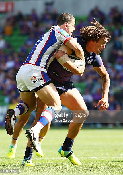 Kevin Proctor of the Storm is tackled by Jarrod Mullen of the Knights during the round five NRL match between the Melbourne Storm and the Newcastle...