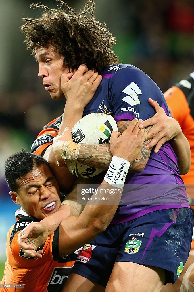 Kevin Proctor of the Storm is tackled during the round 16 NRL match between the Melbourne Storm and Wests Tigers at AAMI Park on June 26, 2016 in Melbourne, Australia.